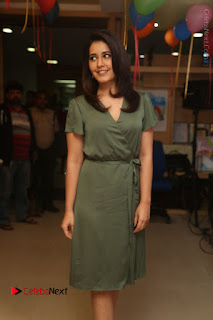 Actress Raashi Khanna Stills in Green Short Dress at Mirchi 95 Suno Aur Mercedes Jeeto Contest  0113.JPG