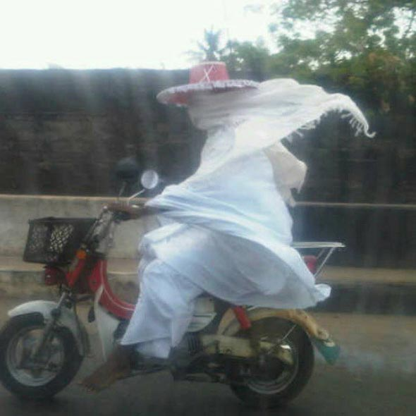 Warrisdis? Caption this photo of Lagos masquerade riding a motocycle