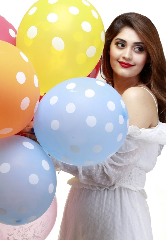 Beautiful Tamil Actress Surabhi Latest Hot Photo shoot In White Dress