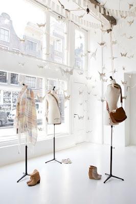 shop paper crane window display