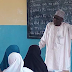 Check: Photos: A Local Government Chairman is pictured teaching primary school pupils in Borno state