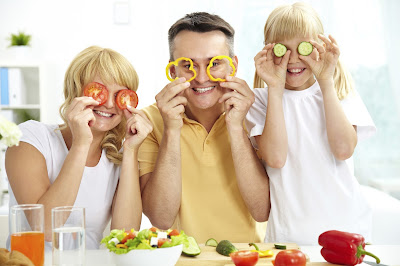 A family showing off healthy foods