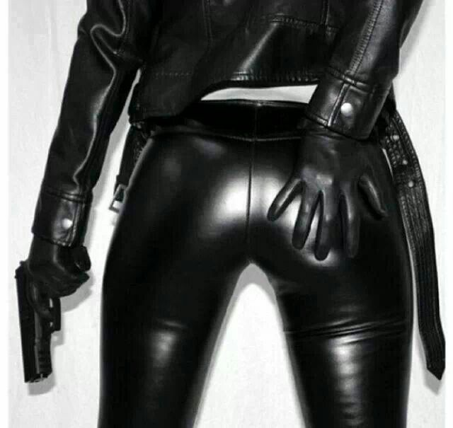 Leather clad girl with gun.