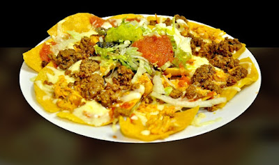 Platter of Super Nachos: Corn chips with taco meat, cheese, and salsa