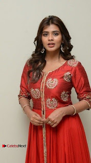 Actress Heba Patel Latest Stills in Red Dress at Mister Movie Trailer Launch Event  0025.jpg