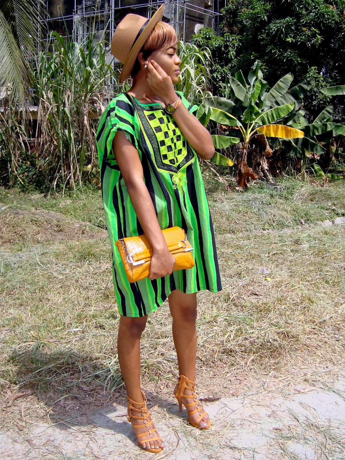 how to style a female agbada with fedora hat and brown gladiator heels - shoe