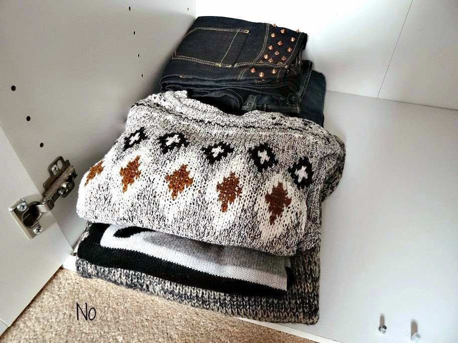 jumpers and jeans organised neatly in your wardobe
