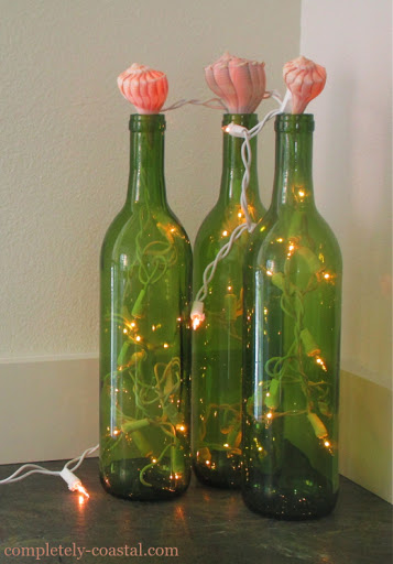 Decorative Wine Bottles with String Lights and Shell Toppers