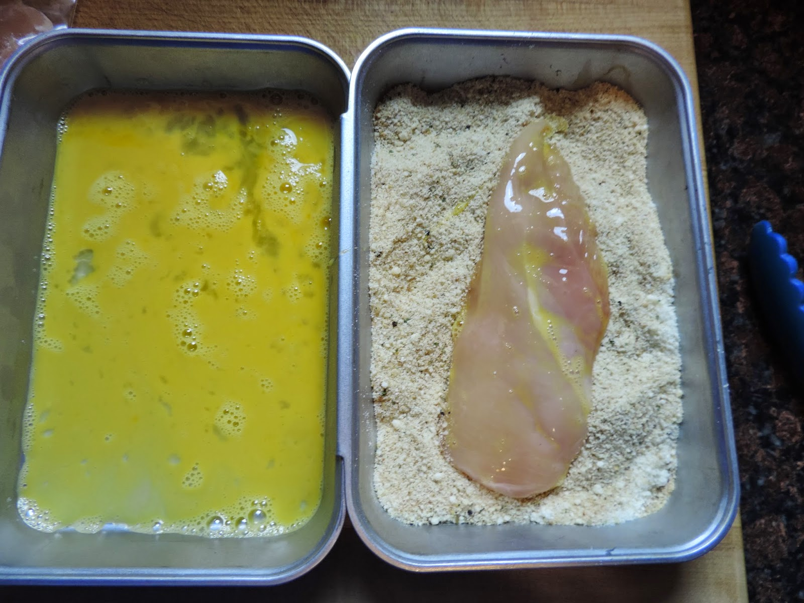 The chicken cutlet being added to the flour mixture.
