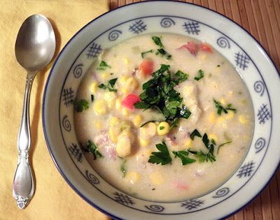 Bowl of Fish and Corn Chowder with spoon and napkin
