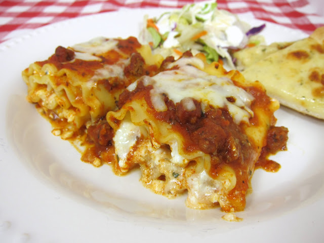 Lasagna Rolls Recipe - Lasagna noodles, topped with cheeses, rolled up  and topped with sauce and mozzarella - great make-ahead meal. Can also freeze unbaked.
