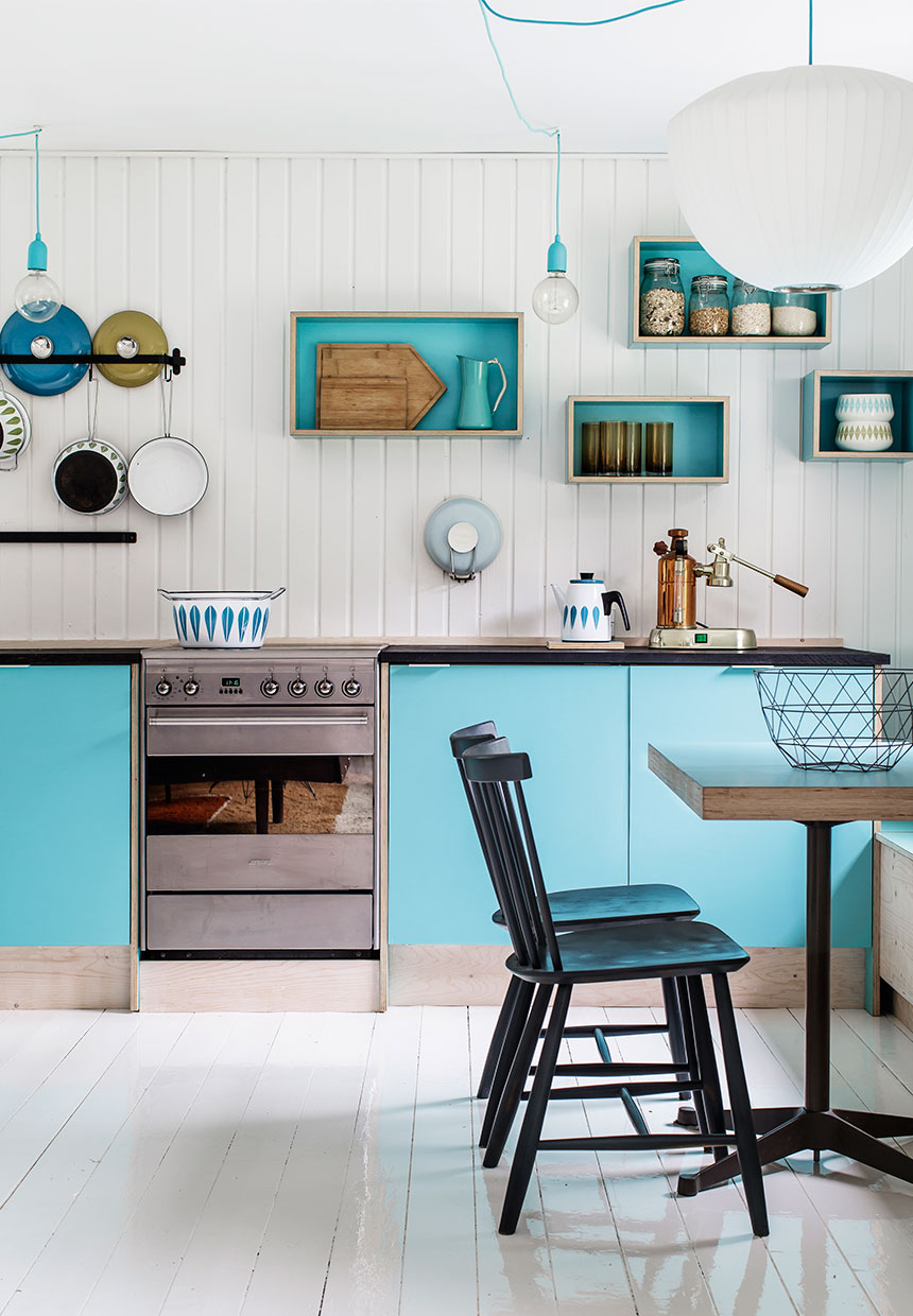 beautiful kitchen in blue color inside of a nordic interior