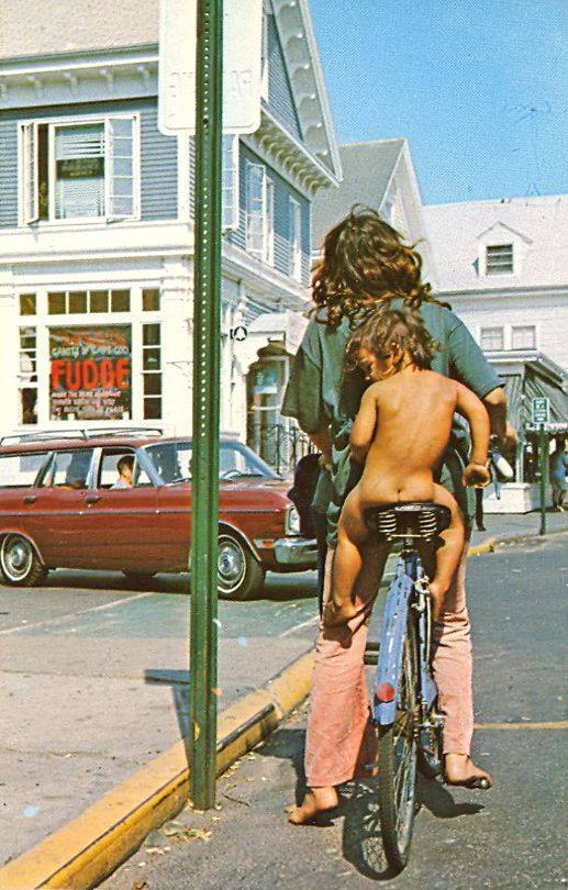 1970s Dads - the original hipsters. Provincetown, MA, 1969. Dad on a bike with kid. The New Dad. marchmatron.com