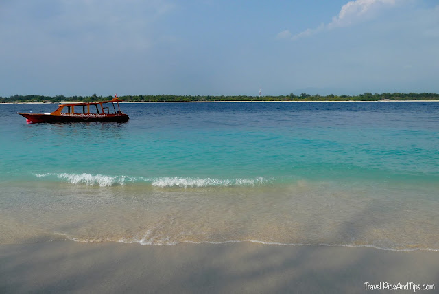 Turquoise sea with boat at Gili Trawangan Indonesia