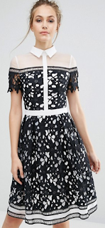 http://www.asos.com/chi-chi-london/chi-chi-london-premium-lace-panelled-dress-with-contrast-collar/prd/7293609?iid=7293609&clr=Blackwhite&SearchQuery=&cid=12970&pgesize=36&pge=1&totalstyles=638&gridsize=3&gridrow=5&gridcolumn=1
