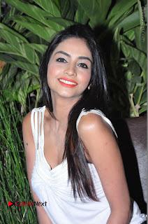 Actress Model Pooja Sri Stills in White Short Dress at F Club pre soft Launch  0119.JPG