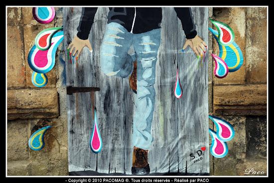 jambes du personnage du street art Sedan Faubourg du Menil