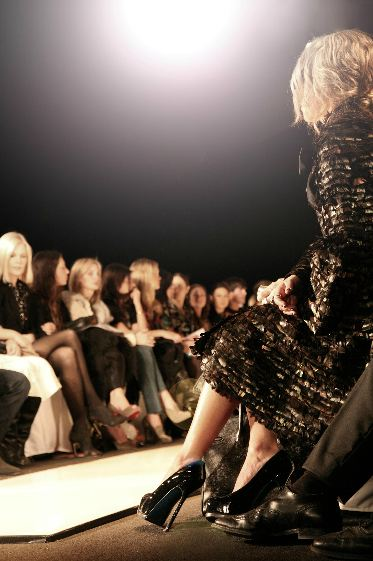 Women sitting in the front row at a fashion show