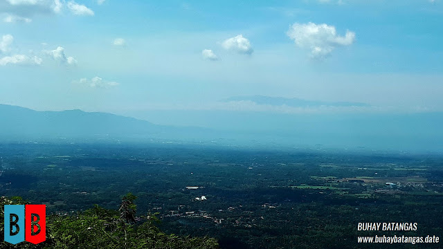 In the distance, obscured by haze, Batangas City, Batangas Bay and the Calumpang Peninsula.