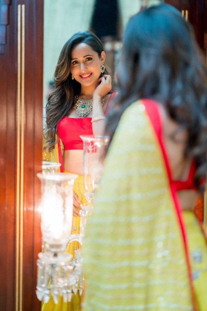 Actress Pragya Jaiswal Latest Photos Shoot In Yellow Lehenga Choli
