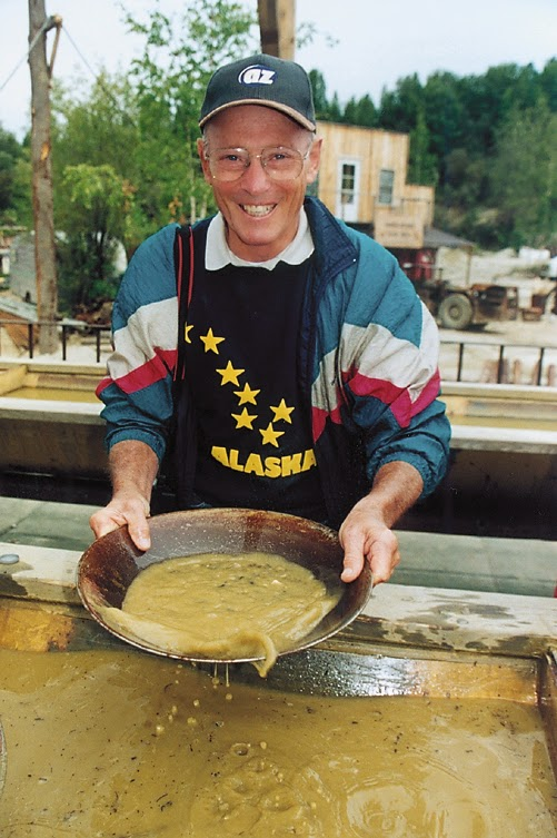 Trying his hand at gold panning in Alaska.