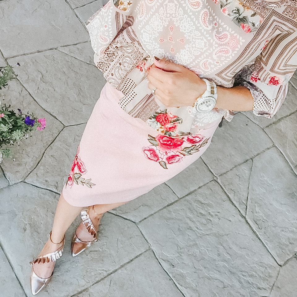 ruffle blouse with blush embroidered floral skirt and ruffle flats