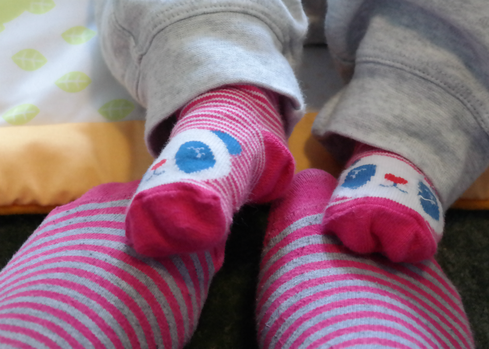 Sarah and Baby Rooftops' feet in pink striped socks