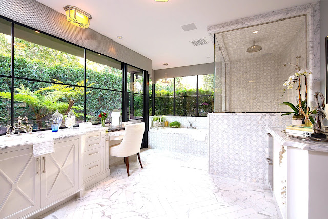 White marble master bathroom wrap around windows