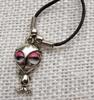 lady alien necklace with pink eyes