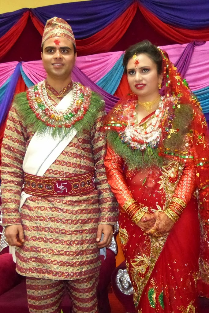 Nepalese groom and bride in traditional wedding dress