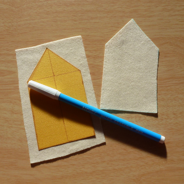 Cardboard template, cream felt sheets and water soluble fabric marker pen