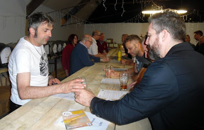 Volunteer barman Scott Mitchell serving a pint during Brigg Beer Festival 2018, held in the Nelthorpe Arms Barn in May and organised by Brigg District Lions Club.