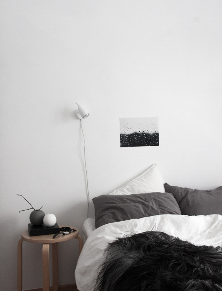 Using a small stool as a nightstand in the bedroom | Decordots