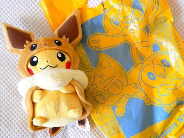 A plushie of Pikachu dressed as Eevee, from the Pokemon Center