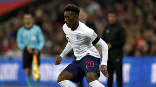 Chelsea youngster in action as he makes his debut for the three Lions