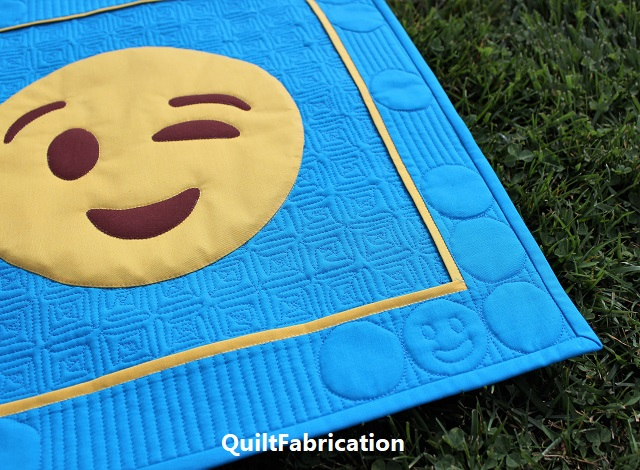 smiling face in the lower quilt corner