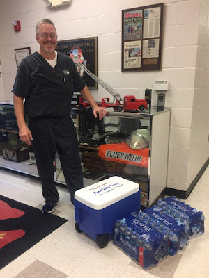 Dr. Kitzmiller delivers water