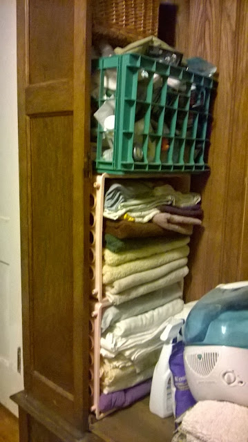 armoire as linen closet