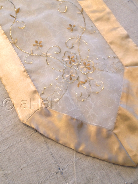 Table runner with scroll work pattern