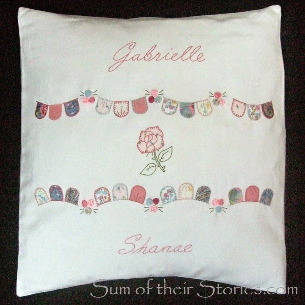 Appliqué and embroidered cushion