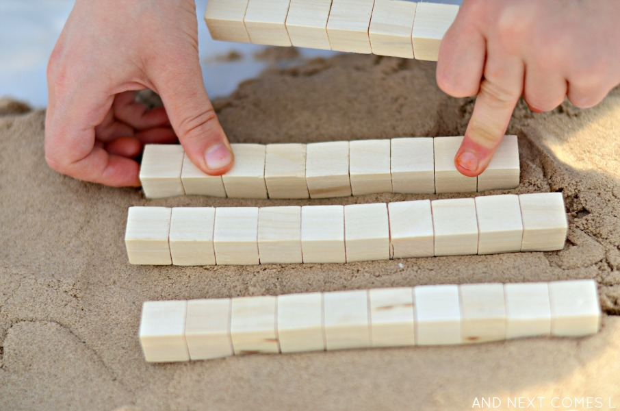 Kinetic sand math activity for kids using base ten blocks from And Next Comes L