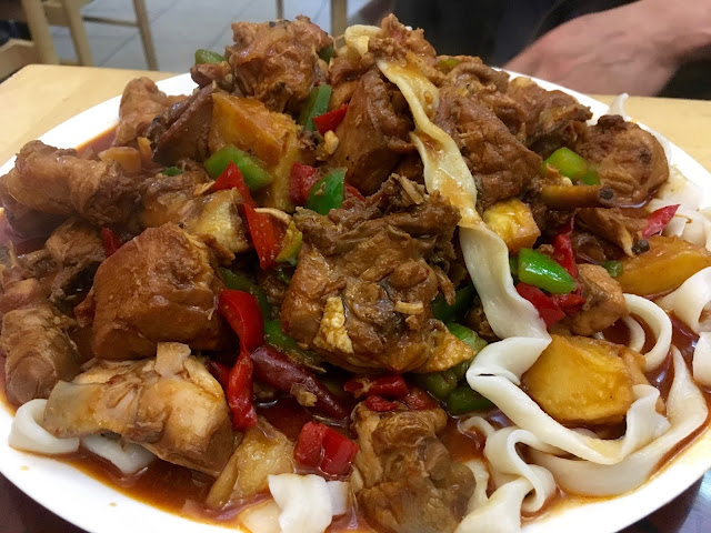 A huge sharing plate of Yangyu Tohu Kormisi at Dolan Uyghur Food Heaven in Melbourne, Australia