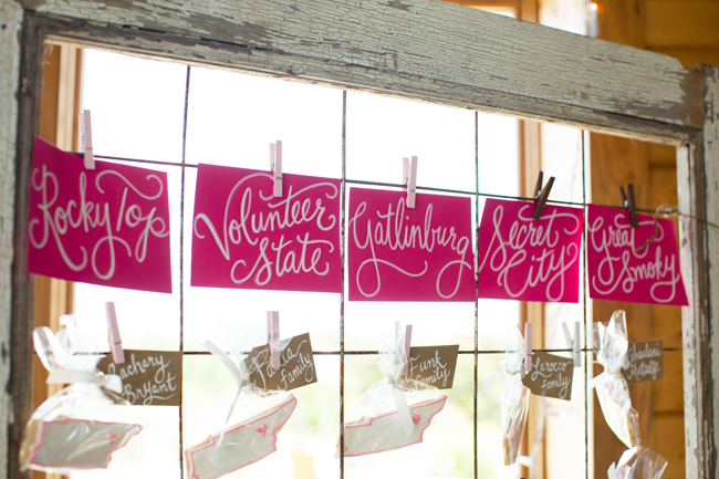 tennessee, hot pink hand lettered table names, window, clothespins, rustic