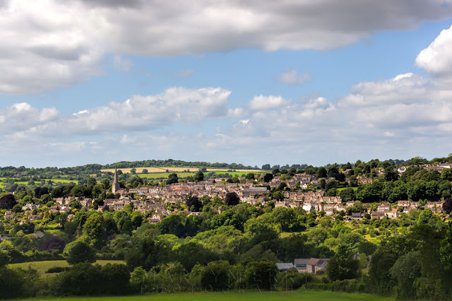 Painswick town surrounded by lush landscape in the West Cotswolds