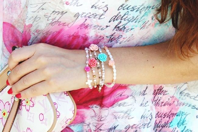 Louis Vuitton purse.Glam Chameleon Jewelry floral bracelets.