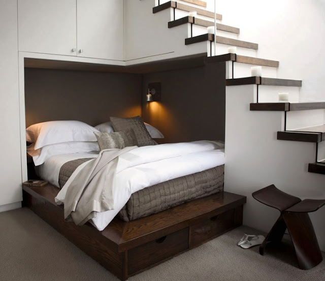 One example of simple space repurposing would be to utilize the unused area under a staircase