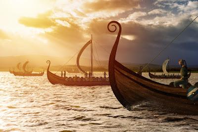 Barcos vikingos surcando los mares camino de Islandia