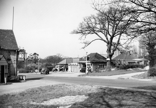 Photograph of Greenleaf's garage and the Swan Hotel in the 1960s. Image by B.H. Warne, digitised by Mike Allen