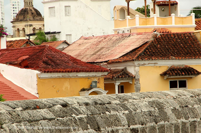 Red rooftops of Cartagena behind the thick city wall.