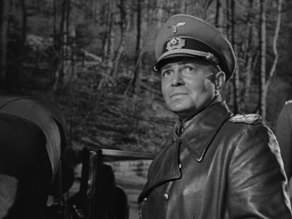 James Mason as Rommel, standing by car